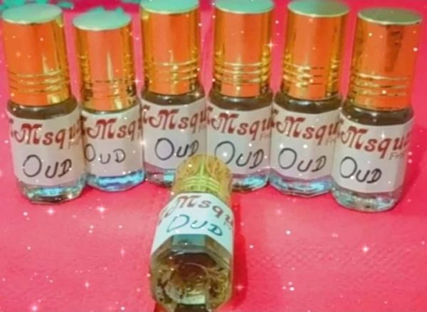'OUDH' with strong sweet oily smell